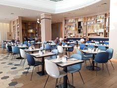 The restaurant has been recently refurbished and given a fresh Mediterranean theme. The décor of the restaurant is white and blue and it accessorised with different sized ceramic pots