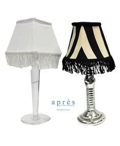 "Table Lamp $15.00 (rental) Clear Acrylic, 7"" or Silver Candlestick, 9"" with White Fringe or Fringed Black/White Stripe Shade"