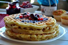 400 gr. flour  60 gr. sugar  3 eggs, separated  500 ml milk  2 sachets vanilla sugar  1/2 teaspoon baking powder  a pinch of baking  one pinch of salt  50 gr. melted butter  syrup and / or jam berries