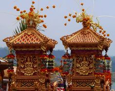 Beautiful carved , small temples decorated and taken from their village temple for a ceremony at Lake Batur,Bali for a Hindu ceremony.