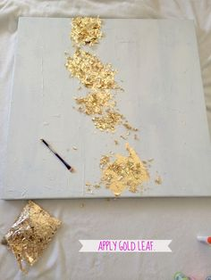 livelovediy.com - paint canvas, impasto paste modeling paste (thick to add texture), glue then add gold leaf flakes