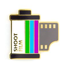"See what develops - Gold pin with colored enamel - Rubber backing - Measures 1"" tall"
