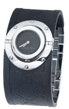 The perfect complement to elegant evening attire, this Gucci Bangle Watch features a rotating case that flips over to draw attention to the patterned rubber bangle watchband. Set in a striking 24-millimeter case with a scratch-resistant sapphire crystal, the sun-brushed black dial features silver hands and a Gucci logo. The case, bezel, and crown are crafted from stainless steel. $306.16