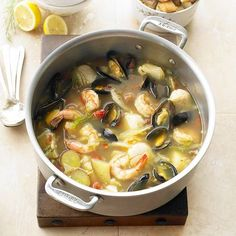 Seafood Bouillabaisse ~ Tender shrimp, scallops, and mussels bubble with saffron, cayenne, and veggies in a savory vegetable broth. A stunning but healthy holiday soup worthy of Christmas dinner! Bouillabaisse Marseille, Seafood Bouillabaisse, Bouillabaisse Recipe, Fish Recipes, Seafood Recipes, Soup Recipes, Cooking Recipes, Seafood Soup, Seafood Dishes