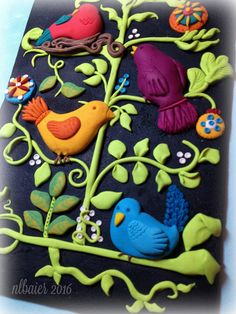 Polymer clay sculpted birds in branches. Decorative wall art mounted to painted canvas board.