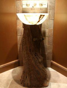 Gorgeous tree trunk bathroom vanity design with smart lighting - Decoist