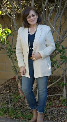 Dress up your skinny jeans with a white linen jacket and pearls. Lemon Lane Style