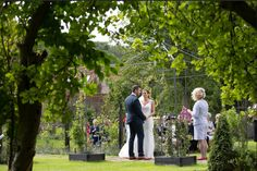 A Wedding Ceremony in The Walled Garden at Sedgeford Hall Norfolk Wedding and Event Venue - Holiday Cottages