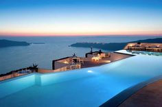 The Grace Hotel In The Santorini Islands. This 5 star luxury hotel features two normal pools, one infinity pool, black sand beaches, and a terrific view of both the Aegean Sea and Skaros, a rock renowned for its Venetian castle ruins. #travel