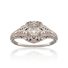 Vintage Diamond Ring, i love rings like this where there is a lot of detailed band work that adds to the stone in the middle whether it be big or small <3