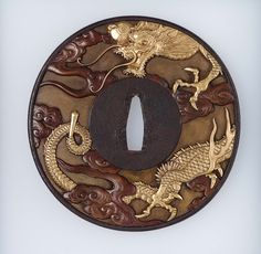 Tsuba with design of dragons and clouds | Museum of Fine Arts, Boston