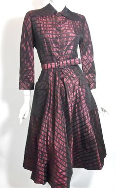 40s shimmering purple and black taffeta New Look dress with wide rounded collar, self belt, full skirt with big hip pockets. Doughnut buttons up bodice, hook and eye at waist with metal zip center front of skirt within pleats.
