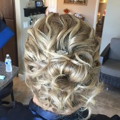 Curly Blonde Low Bun Updo