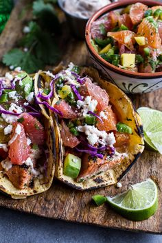 Cuban Fish Tacos with Citrus Mango Slaw + Chipotle Lime Crema. (halfbakedharvest)