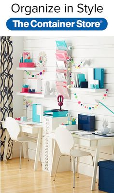 Create an organized study space for two. The shelves on the wall make use of vertical space while allowing you to personalize each area. Don't forget the hanging file folders – a great way to organize projects. Small desks and comfy chairs are big on style.