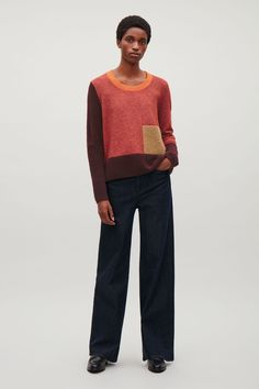 This jumper is made from a warm wool blend with a contrasting cotton-knit collar and fuzzy mohair-blend pocket. A relaxed fit, it is completed with a round neckline and ribbed trims at the hemline and cuffs.