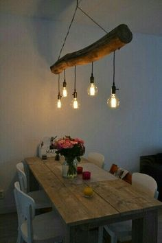 Rustic light fixture made out of a log.