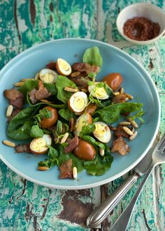 salad of quails eggs poached in rooibos tea with crispy bacon
