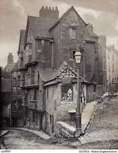 "The junction of Steep Street and Trenchard Street, Bristol, England 1866 [[MORE]] Some detail: John Hill Morgan (b 1833), platinum print. ""R Holloway Dealer in Marine Stores"" Locals would have called this a ""rag and bone shop"". Now that means a..."