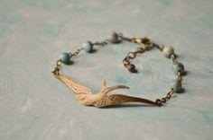 Antique bronze soaring bird bracelet w/ teal/brown natural stones.