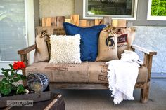 Pallet wood outdoor sofa with coffee bean sack pillows and upholstery, via Funky Junk Interiors
