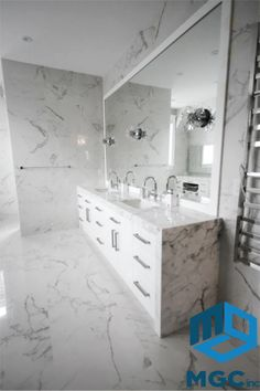 Statuario everywhere. Marble for the vanity and porcelain for the floors. Now that's a washroom everyone would love! #MGC #Fabrication #Renovation #Custom #Residential #Commercial #Countertop #Renos #HomeRenos #Toronto #GTA #Classy #KitchenDesign #Design #Quartz #Granite #Marble #Porcelain #Quartzite #Modern #Furniture #Luxury #Homestars #Vanity #Master #Ensuite #Statuario