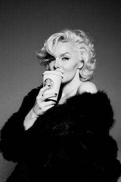 Millennial Marilyn Monroe lookalike holding starbucks coffee
