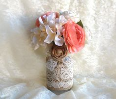 burlap and lace covered rustic mason jar vases wedding decoration