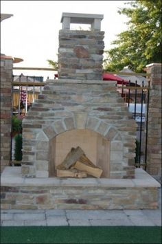 elegant stone fireplace for the patio with raised hearth