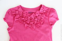 turn a long sleeve shirt into a short sleeves.....and use the sleeve scraps to add bows to the front