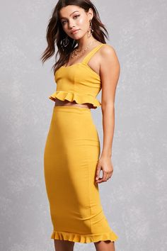 A stretch-knit pencil skirt featuring a high-rise waist, an elasticized waistband, and ruffle-hem detailing with a back slit.  (Matching top available.)<p>- This is an independent brand and not a Forever 21 branded item.</p>