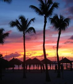 """We were in Aruba and this was the best sunset of the entire nine-night trip. The blues, oranges, and pinks blended together to create a nice background to the palm trees."" (From: 45 Beautiful Caribbean Escapes: It's Not Too Late!)"