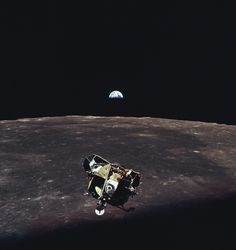 With the Earth visible in the vast distance above the moon's bleak horizon, Apollo 11's lunar module ascends toward the command module (piloted by NASA astronaut Michael Collins while Armstrong and Aldrin were on the lunar surface).