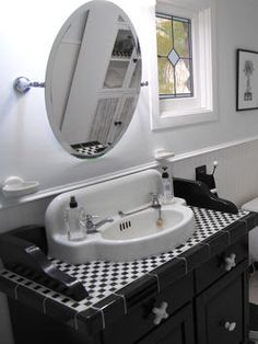 Vintage dresser turned bathroom sink/vanity