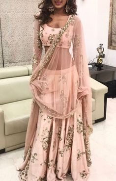 See we talked about how with the cream and gold one you can do a lot of sheer stuff, see something like this where the sleeves are sheer. #indianfashion,