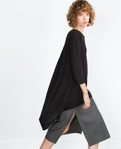 Curly bangs and curly mid-length hair on Zara model wearling Long Asymmetric Top, Fall 2015 http://www.zara.com/us/en/trf/t-shirts/long-asymmetric-top-c269214p3043533.html