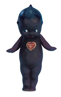 "Very Rare Kewpie as Brown Complexioned Hot'n'Tot  6"" (15 cm.) All-bisque standing Kewpie with rich brown complexion,black painted hair,has black painted right-glancing eye,and jointed arms. Marked O'Neill on feet and with red heart paper label. A very rare model marketed by O'Neill as Hot'n'Tot. Germany,circa 1915."