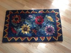 Pattern from Searsport Rugs. Colored planned with Diane Stoffel hooked by L. Boehle.