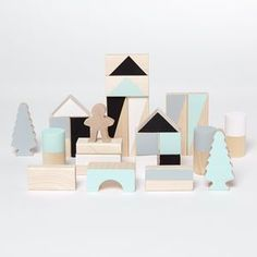 Monochrome And Mint Small Wooden Blocks. Discover thoughtful, cute and wonderfully unique gifts for babies at notonthehighstreet.com. As seen at Stylist Live.