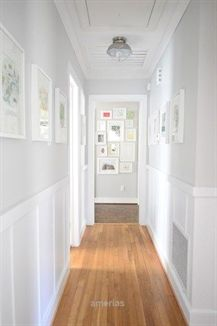 Benjamin Moore Moonshine is a bright panit colour for a dark hallway. Looks good… Benjamin Moore Moonshine is a bright panit colour for a dark hallway. Looks good with board and batten, wainscoting and wood flooring by Young House Love Flur Design, Upstairs Hallway, Upstairs Landing, Grey Walls, Light Gray Walls, Light Grey Paint Colors, Light Colors, Gray Color, New Wall