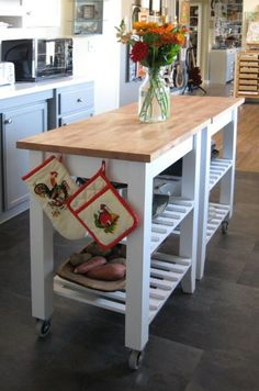 a kitchen island made of 2 IKEA Bekvam carts on casters