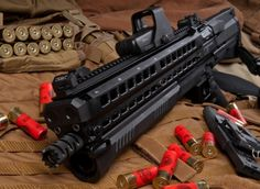 UTS-15 semi-auto shotgun. Capacity: 14+1! Load one side with buckshot, the other with slugs. Switch between the two manually, or automatically switch with every shot. This is the ultimate in shotgun mastery badassery.