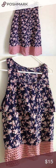 "Floral Patch Top Colors are navy and peach floral with one patch on bottom. Split on both sides. 100% rayon. Lightweight. Measurement laying flat: bust: 19.5"" length: 25.5"" Kenar Tops Blouses"