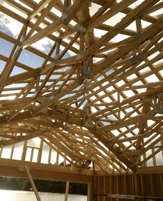 The truss roof looks a bit intense from the underside. Hats off to Toby and his team for putting it all together with all this snow. - Project: Morgan Bay Boathouse Building design by: Construction by: Lumber by: Dock by Engineering by: - Boathouse, Building Design, Foundation, Engineering, Construction, Snow, Steel, Architecture, Hats