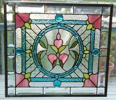 Bonjour Yolanda, c'est ce vitrail dont on a  parlé : j'aime les couleurs (bleu clair, rose, vert) Victorian Stained Glass Panels - Foter