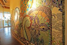 One of many mosaic murals by artist Chris Cocklin Ray in the High Point Neighborhood Center in West Seattle -- portraying water and salmon cycles.