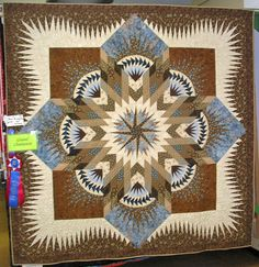 Hawaiian Star ~ Quiltworx.com  Made by Jane McLaughlin  Jan named her quilt The Magic of Potter Marsh. She won the First Prize Class Champion, Grand Champion and People's Choise in the 2010 Tanana Valley State Fair, Fairbanks Alaska.