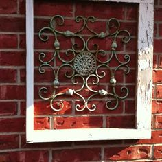 Old window frame from salvage and wrought iron decor from Hobby Lobby. Outdoor wall decor