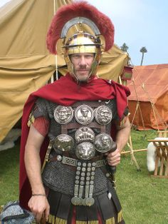 BODY ARMOR - Roman. Centurion, as judged by the gladius on his left and the sideways plume.