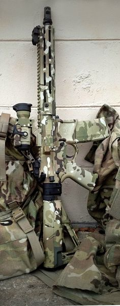 AR-15 Multi-cam job by Joint Force Enterprises.
